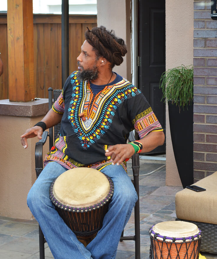 Baba Ras D musician on bongo for a ONE LOVE first birthday party.