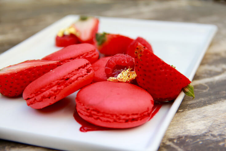 Raspberry French Macarons make a romantic Valentine's Dessert. Last Minute Valentines Party Food Ideas on Halfpint Design. Red food