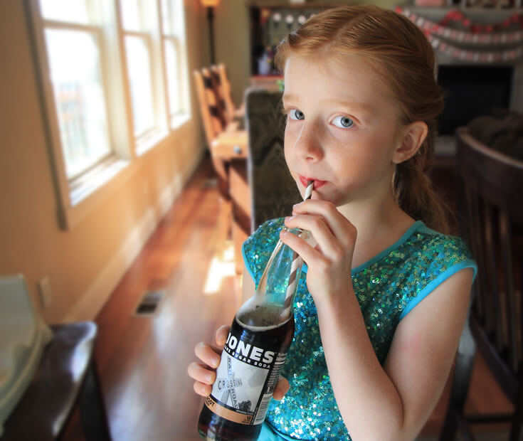 The girls felt fancy drinking their soda from glass bottles with cute paper straws. Movie Star Party, Oscar Party, Rock Star Party on Halfpint Design
