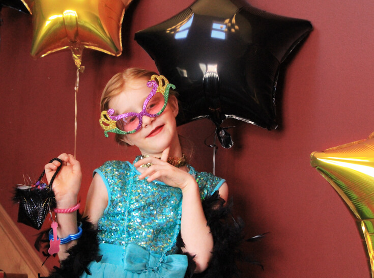 Birthday girl in a movie star photoshoot trying to strike a pose! Halfpint Design. Movie party, Oscar party, Rock Star party ideas.