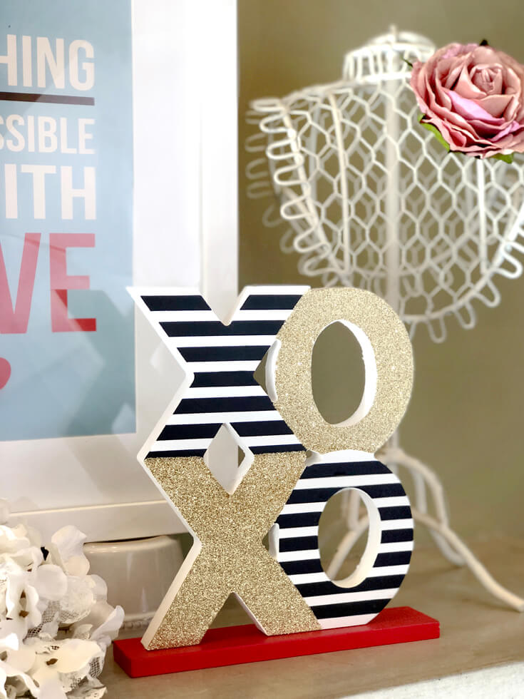 XOXO wooden letters with wire jewelry bust with rose for Romantic Valentine's Day mantel decor. On Halfpint Design.