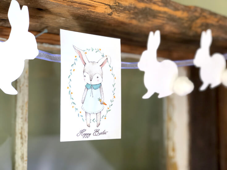 Banner with cut rabbits and cotton tails and darling Easter bunny graphic