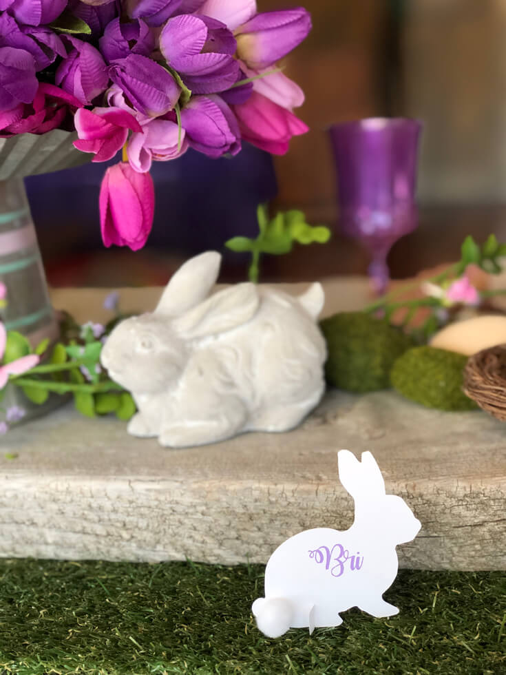 Ceramic bunny on wooden board with tulips and a downloadable bunny place card.