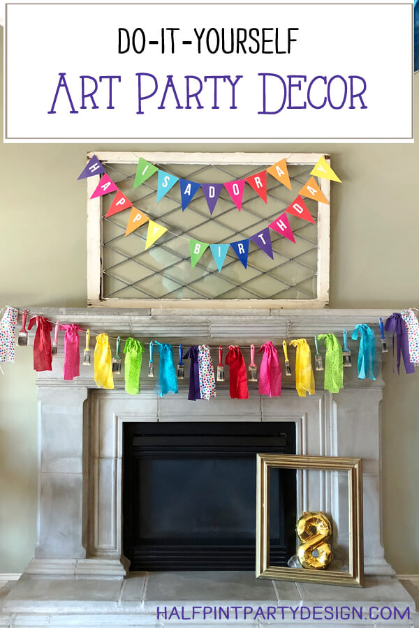 Mantel decorated with rainbow banners for an Art themed Birthday Party