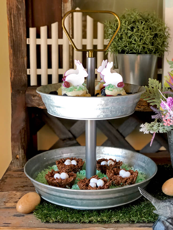 Bunny topped berry shortcakes and chocolate bird nests in a 2 tiered galvanized tray.