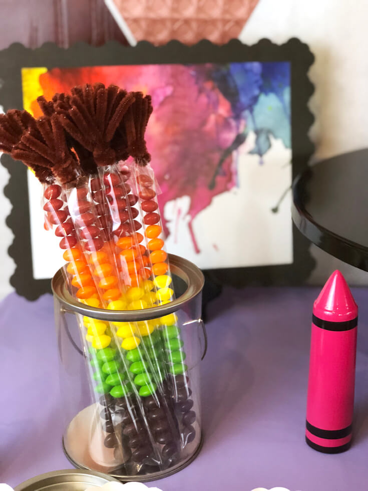 Rainbow Skittle sticks turned paint brushes are a fun favor and snack for an Art themed birthday party where you can party like Picasso! Halfpint Design. Art party, painting party, rainbow party.