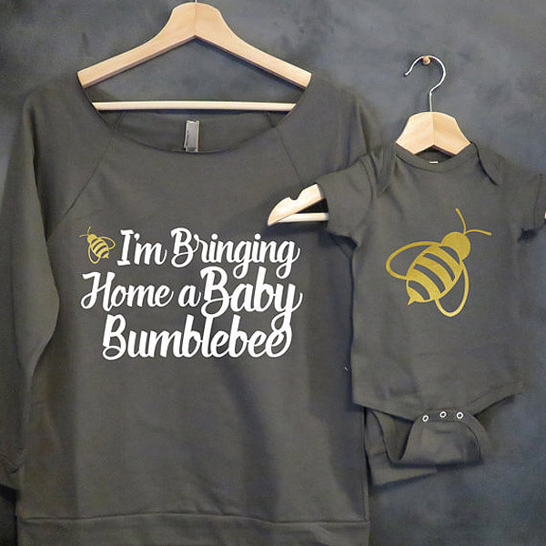 "Black maternity shirt reading ""I'm bringing home a baby bumble bee"" and a black onesie with a bee printed on it."