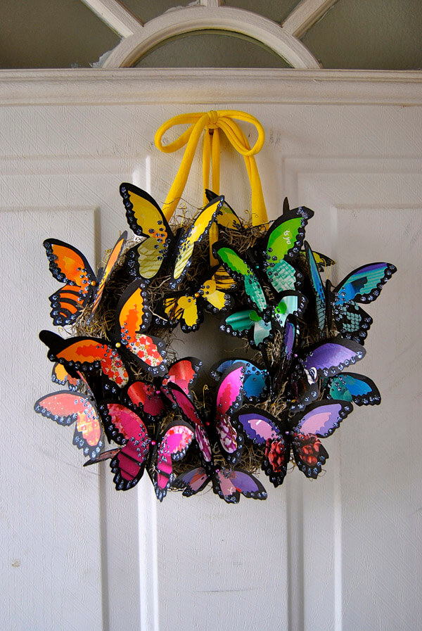 Colorful butterfly wreath on door for an enchanted butterfly party.