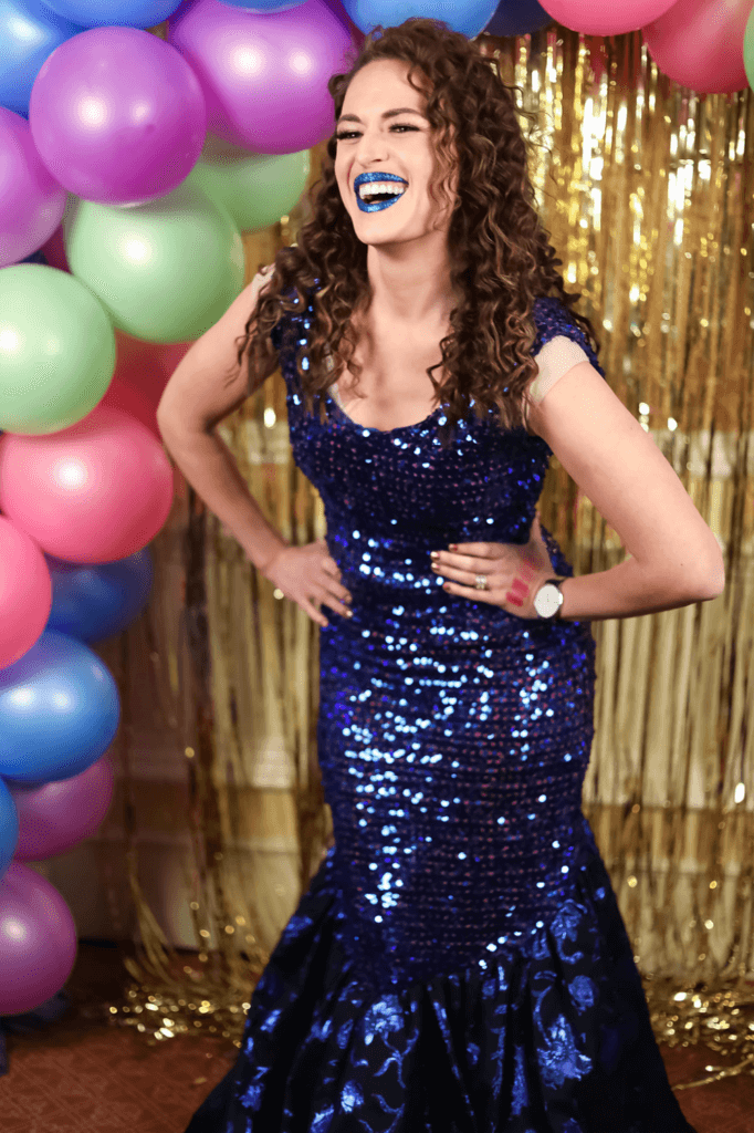 Girl in blue sequin dress with blue lips at an 80's prom party for SNAP conference