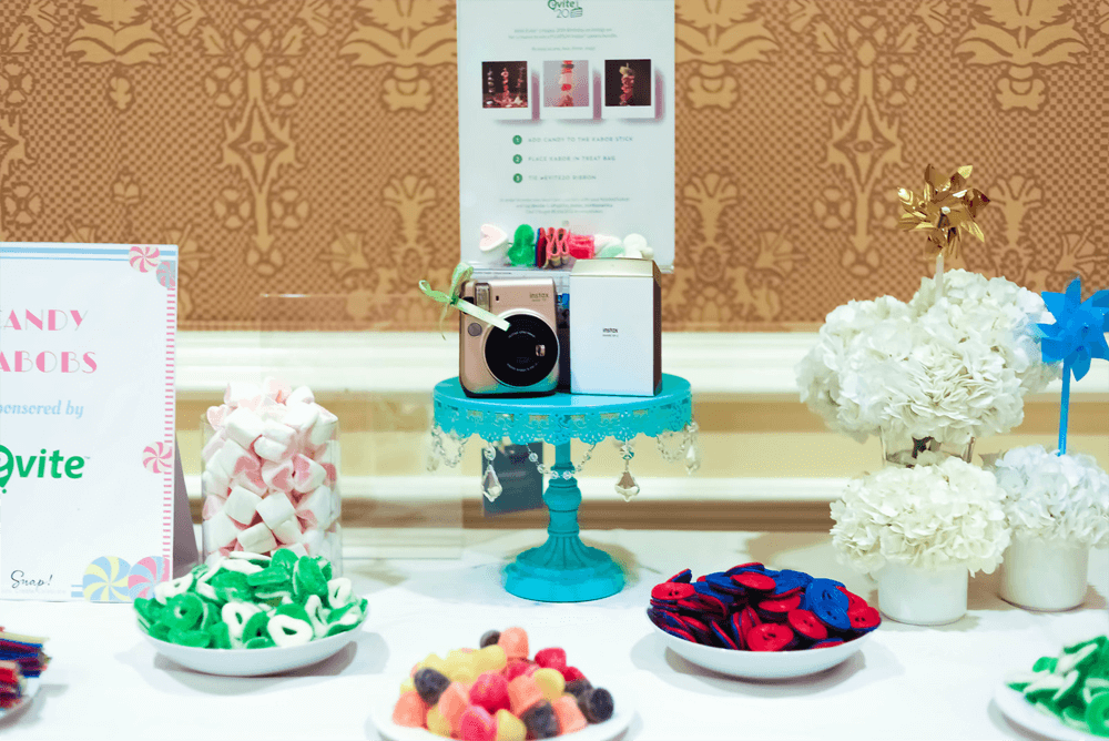 Instax camera giveaway by evite on their DIY candy kabob table at SNAP conference