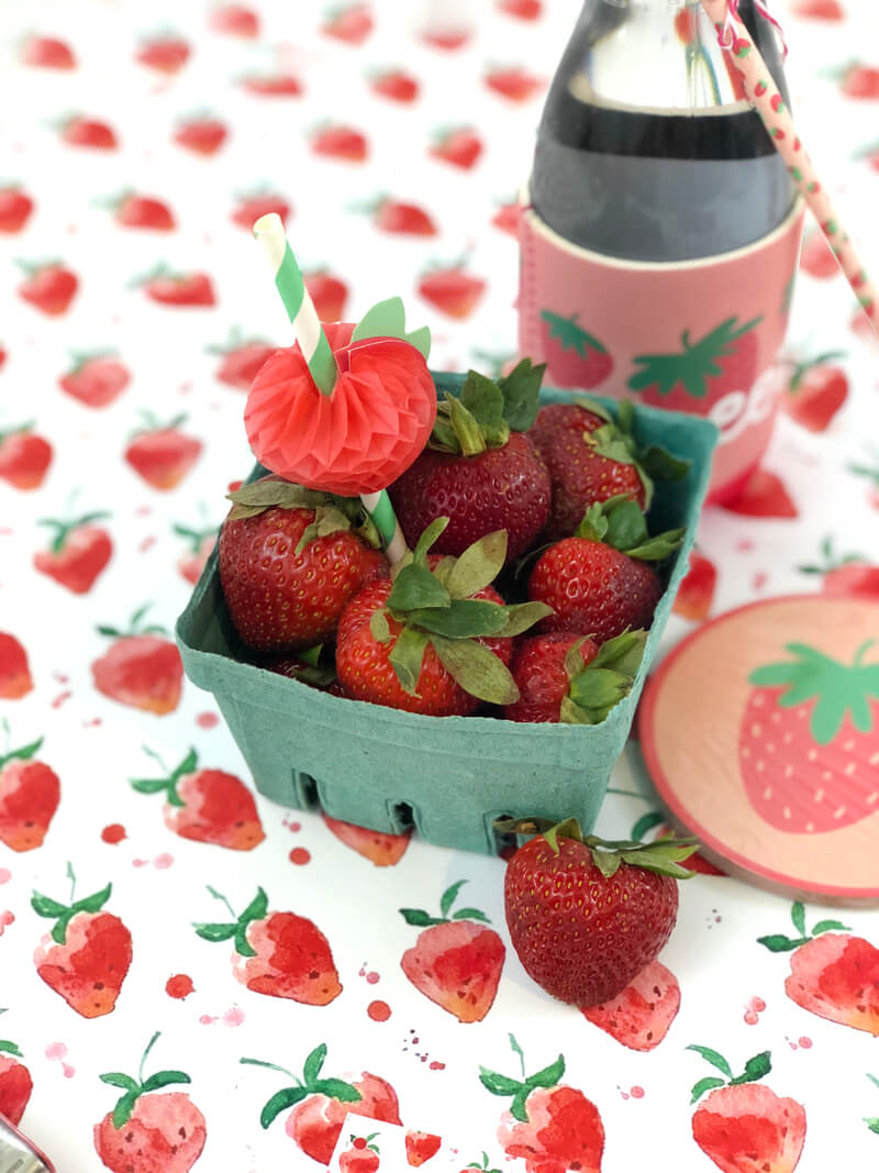 Berry basket full of strawberries on strawberry printed paper for berry sweet summer teacher gift