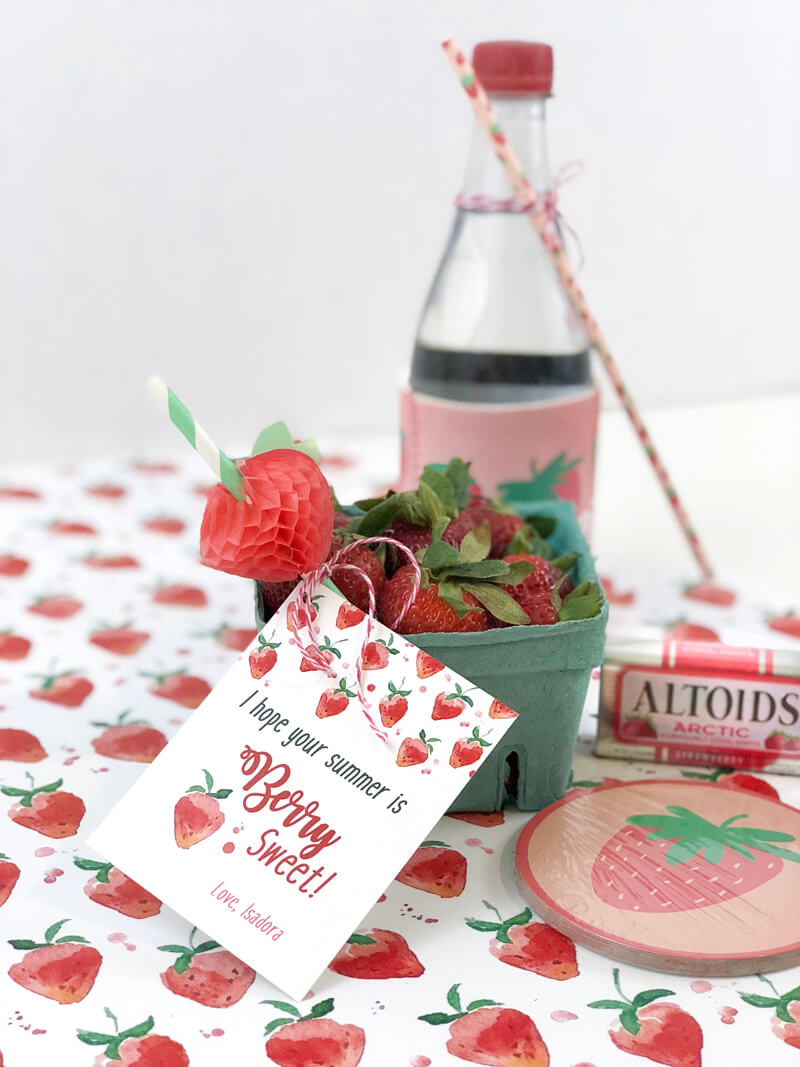 Strawberry themed treats on strawberry printed paper for berry sweet summer teacher gift