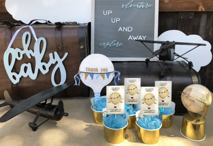 Hot Air Balloon Baby Shower Favors on table with travel themed accessories