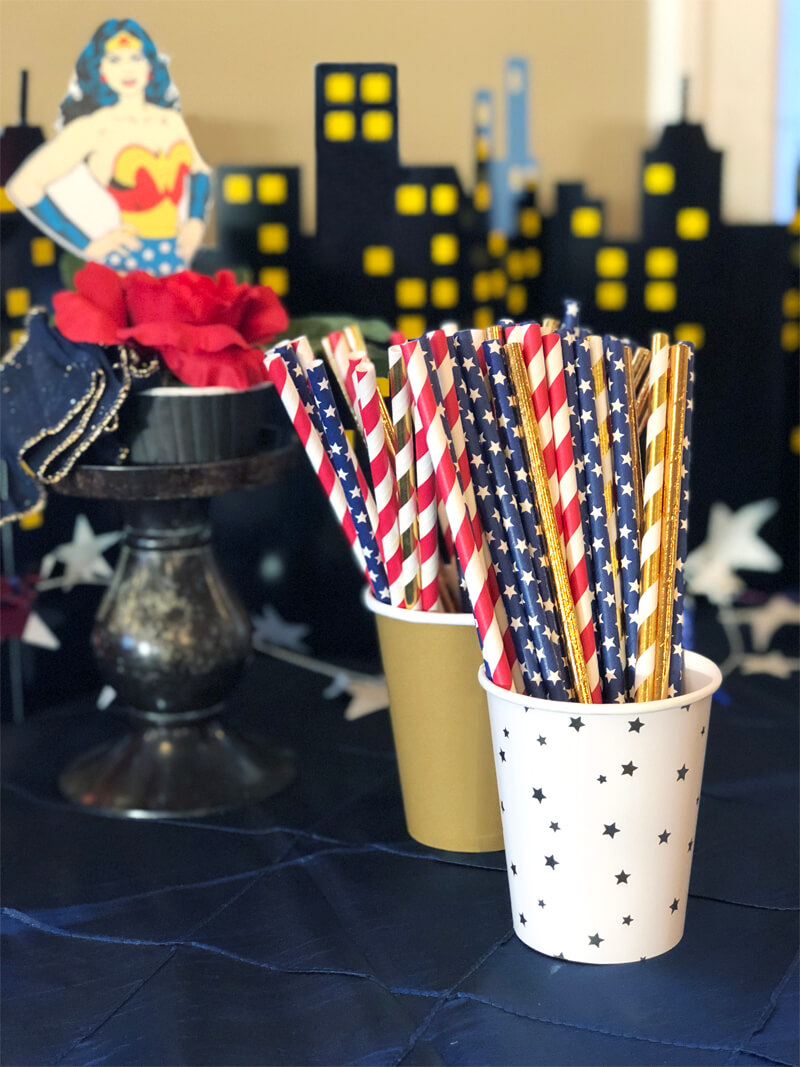 Stars and stripes party straws in cups for a Wonder Woman party