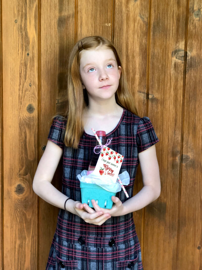 Girl holding gift basket for a Berry Sweet Summer Teacher gift