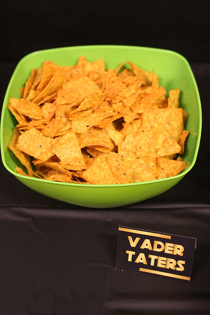 """Bowl of chips with a label """"Vader Taters"""" for a Star Wars Birthday Party"""