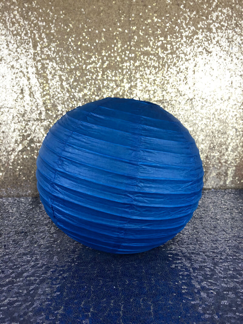 Blue paper lantern for a Wonder Woman themed floral lantern centerpiece.