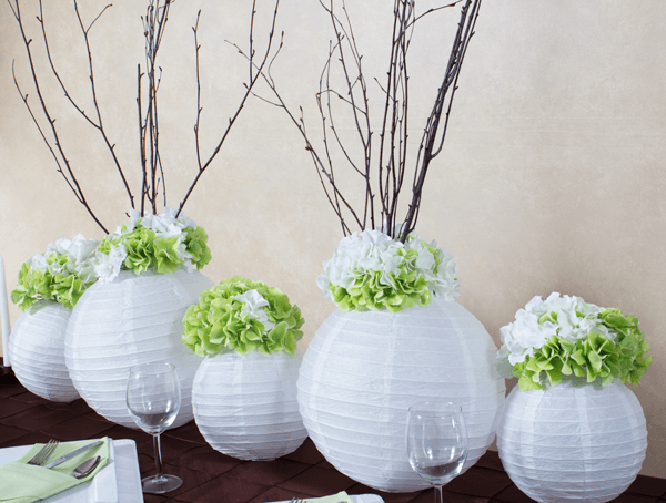 White paper lanterns with hydrangeas and branches