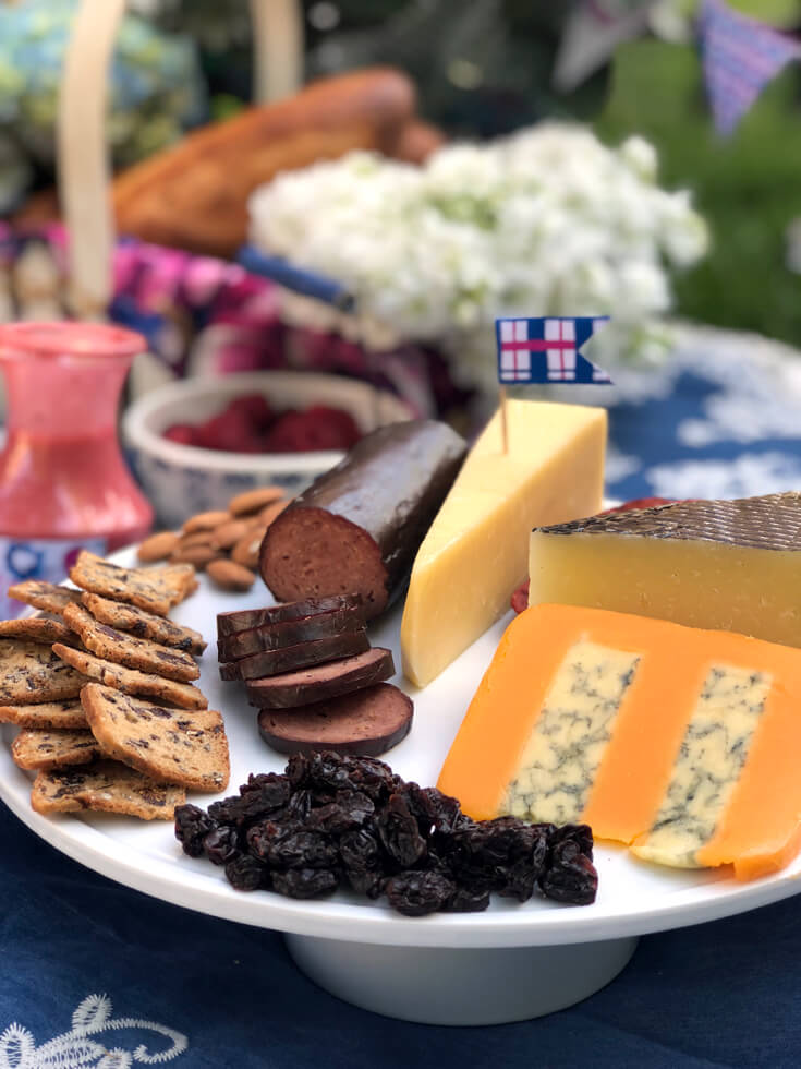 Meat and cheese tray with plaid flag pick at charming summer picnic party
