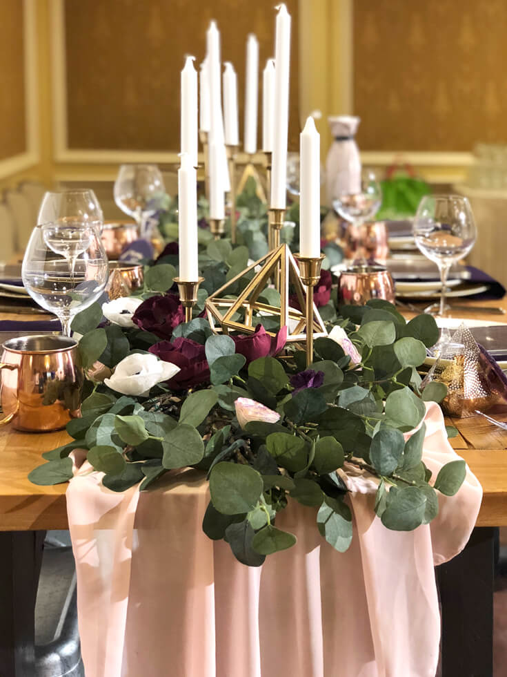 Dinner party tablescape with eucalyptus and white taper candles for Cricut made DIY gift ideas
