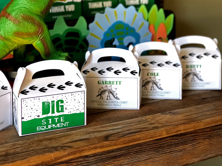 Dig site equipment boxes for each party guest for a dino dig party activity.