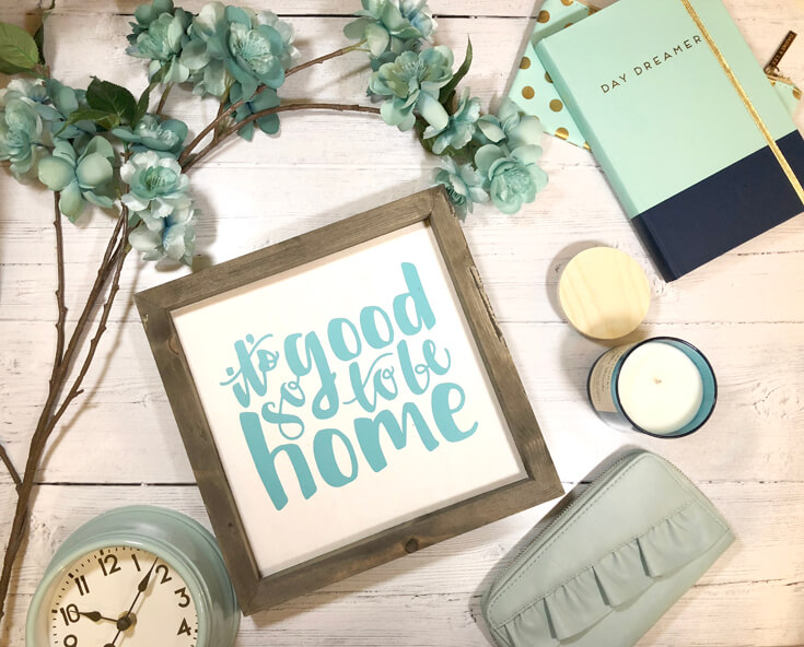 It's good to be home sign on wood background with accessories during class at the Cricut Mountain Make-a-thon
