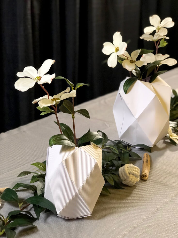 Geometric vases on table with dogwood flowers from Cricut Mountain Make-a-thon.
