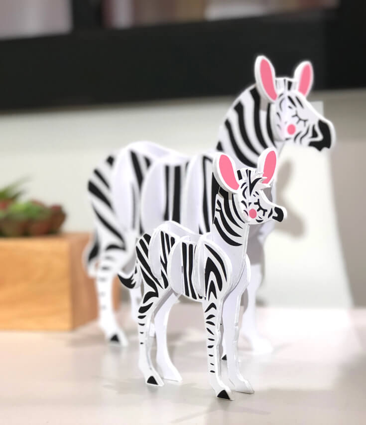 Mother and baby zebra figures made out of wood are great Cricut made DIY gift idea