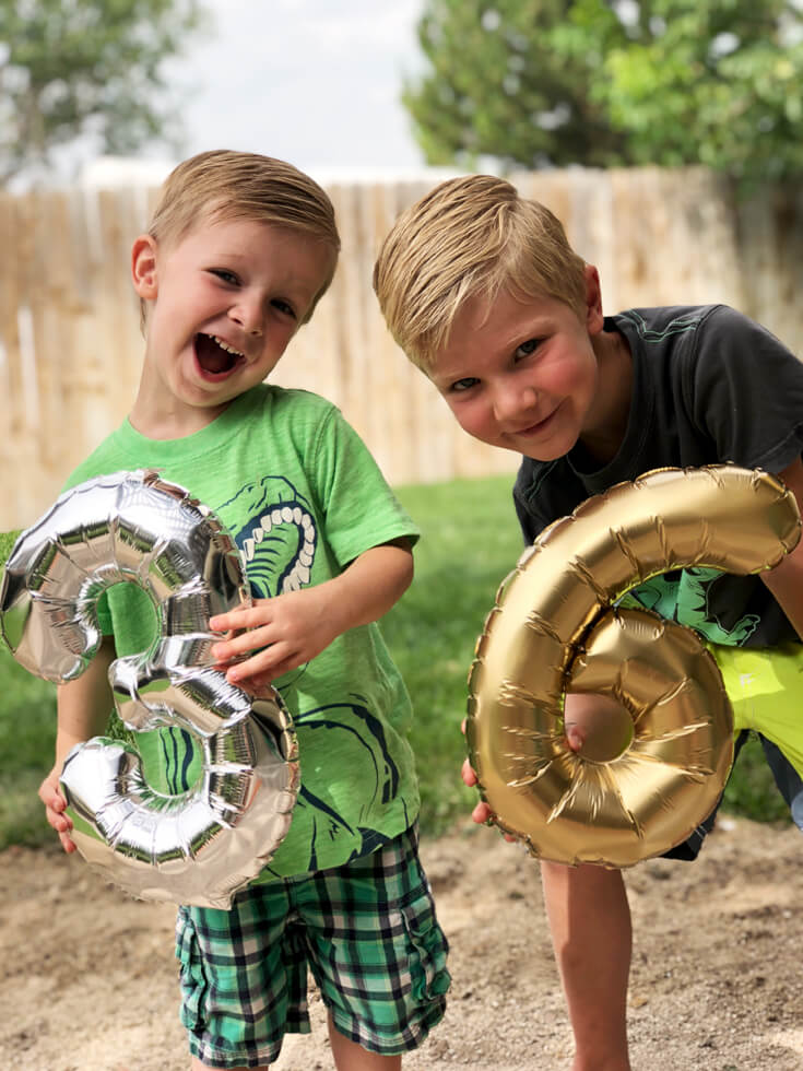 Summer birthday boys celebrate with a dinosaur birthday party