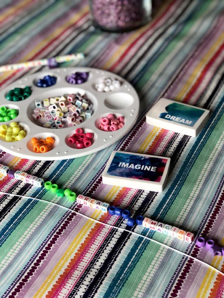 Keeping little artists busy making bracelets with rainbow colored beads