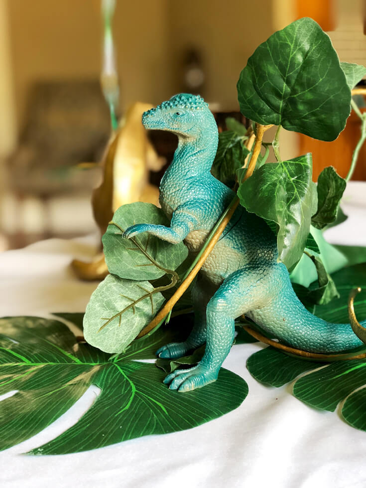 Hiding dinosaurs throughout the table at a dinosaur birthday party