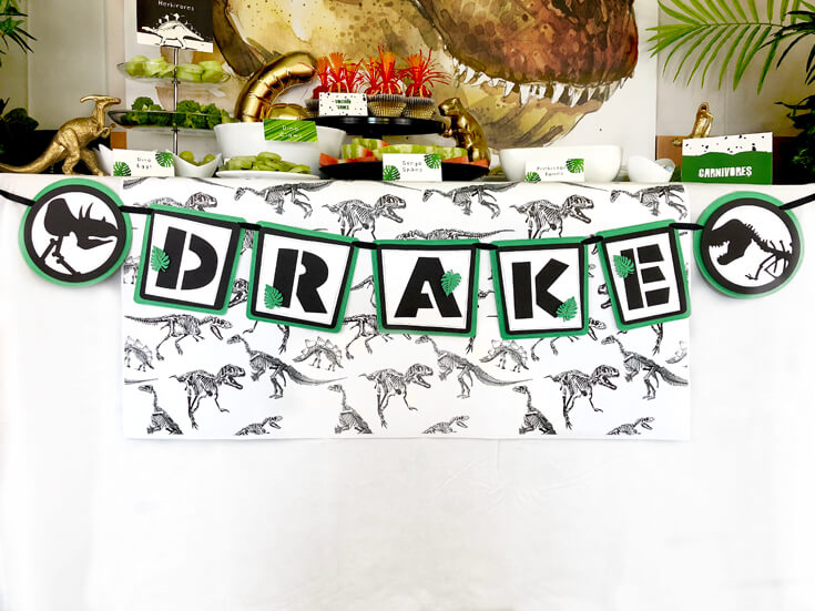 Customized dinosaur name banner for a dinosaur birthday party idea