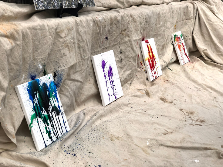 Keeping little artists busy with squirt gun painting on several outdoor canvases