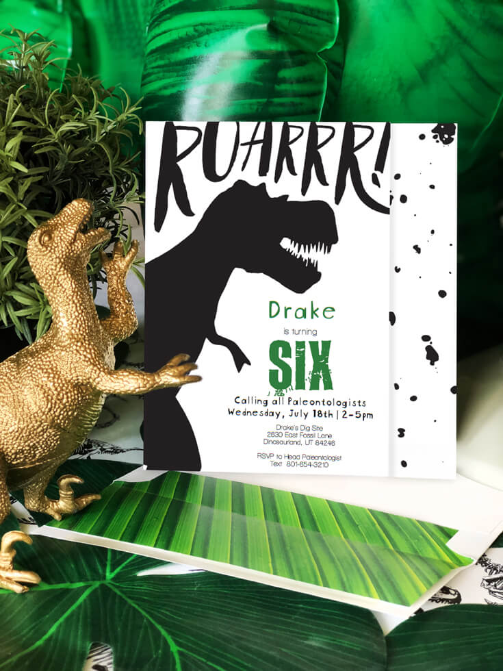 T-Rex inspired invitations with palm leaf background are a fun dinosaur birthday party idea!