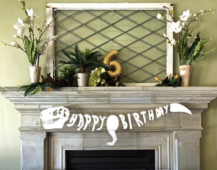 Dino themed fireplace mantel is a great Naming regular foods something fun and festive is a great dinosaur birthday party idea!