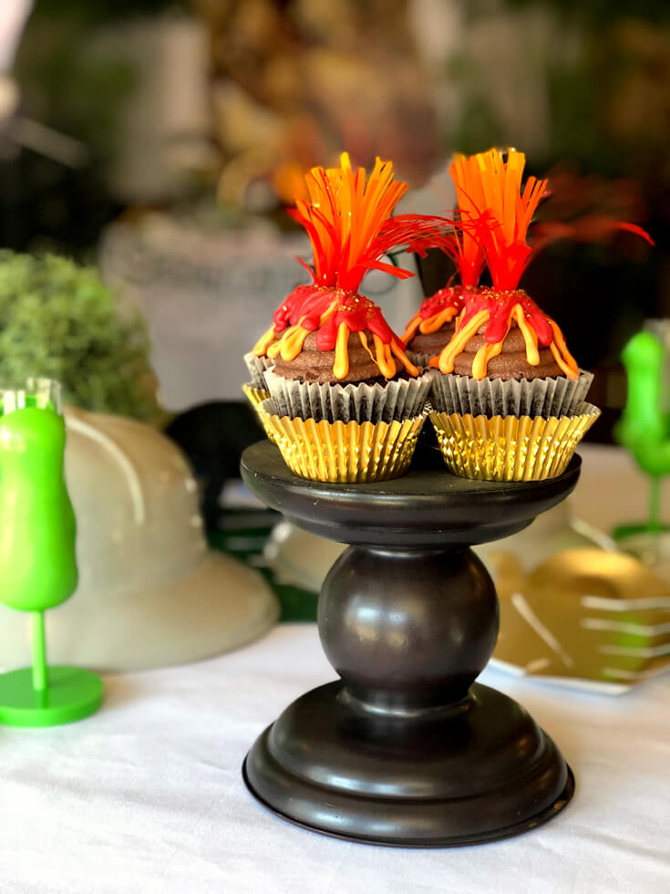 Volcano cupcakes on a stand. A perfect dinosaur birthday party idea!