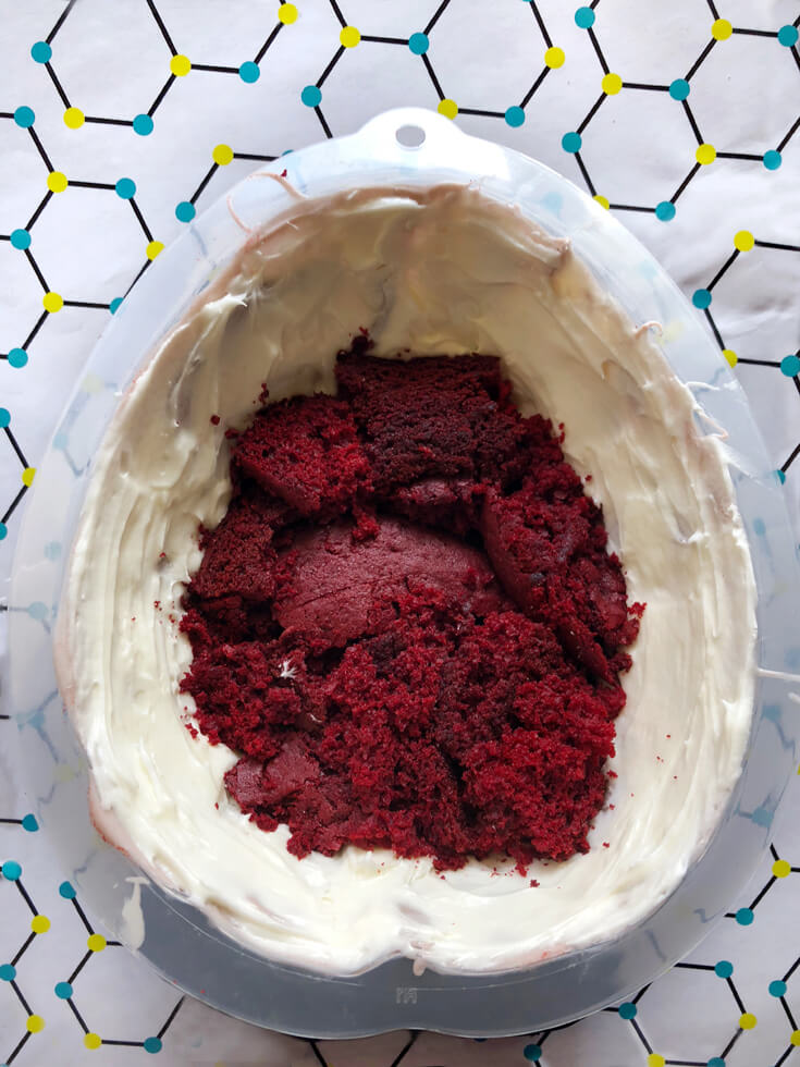 First crumbled cake layer for a red velvet Brain Cake tutorial