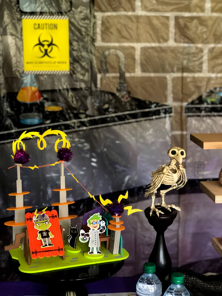 A monster lab decor kit makes a simple Halloween centerpiece for a mad science party