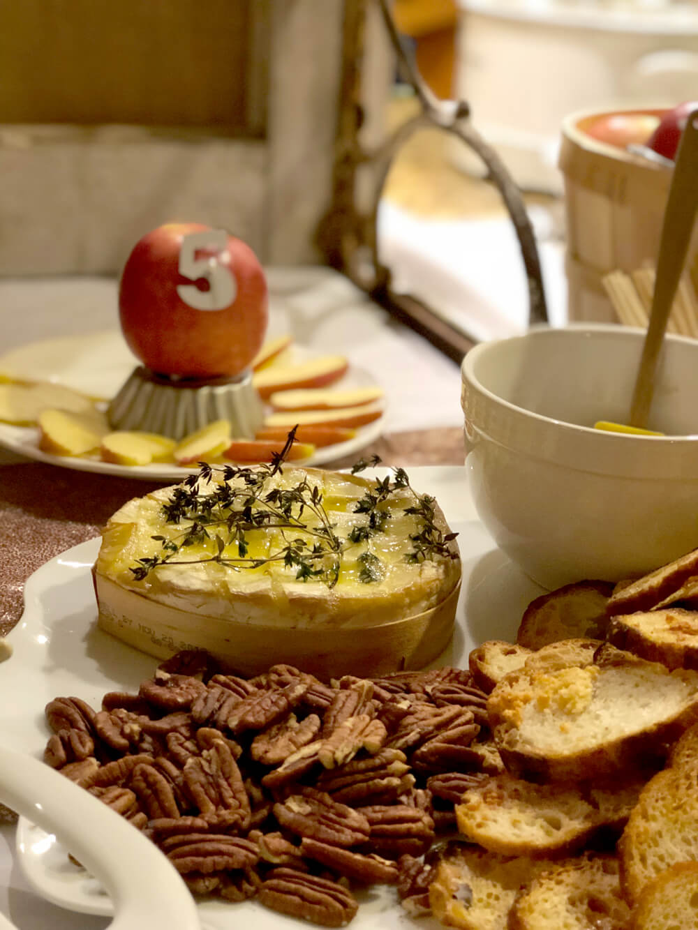 Baked brie, crostini, pecans, and jalapeno jelly for girls night harvest party menu ideas