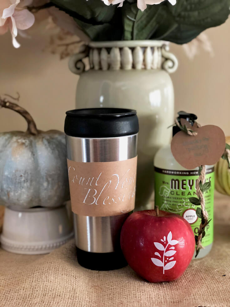 Mug, apple, and apple soap as girls night harvest party favor