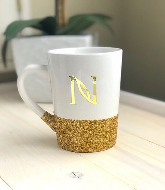 A glitter bottom mug with gold initial as handmade gift idea for her