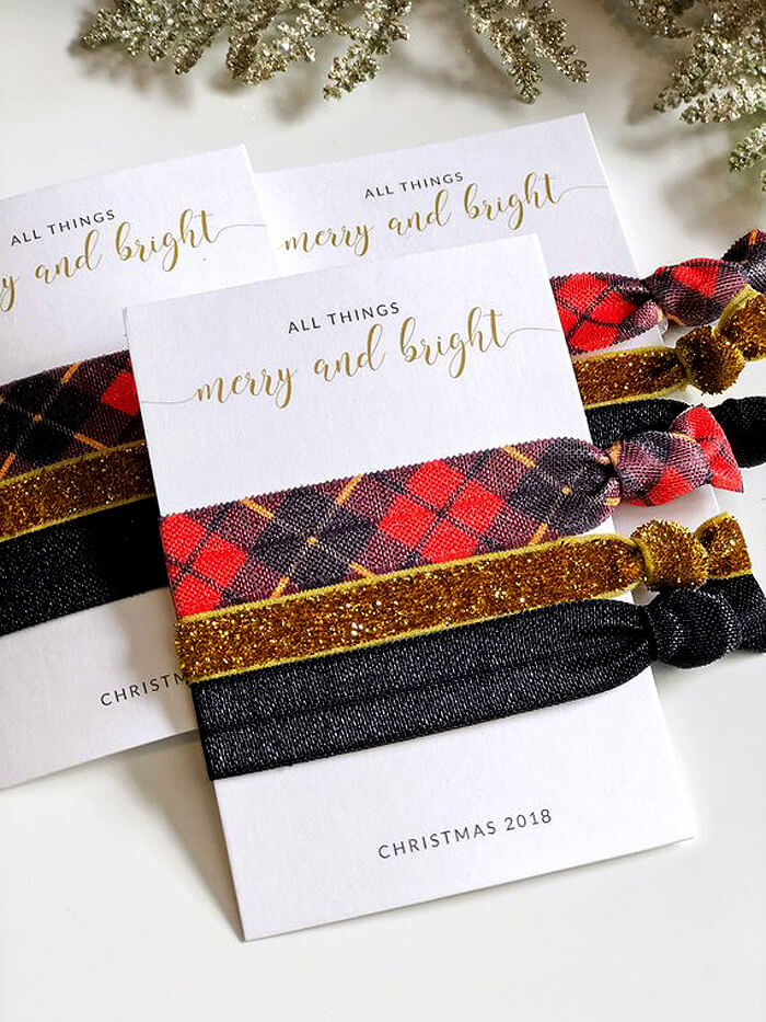 Red plaid, gold, and black hair ties as handmade gift idea for her