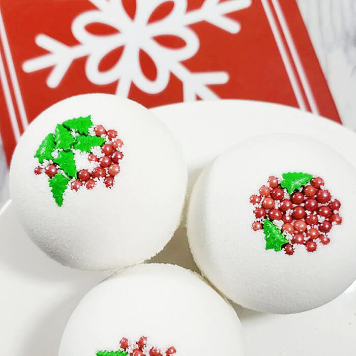 White bath bomb with red berried and green holly leaves as handmade gift idea for her