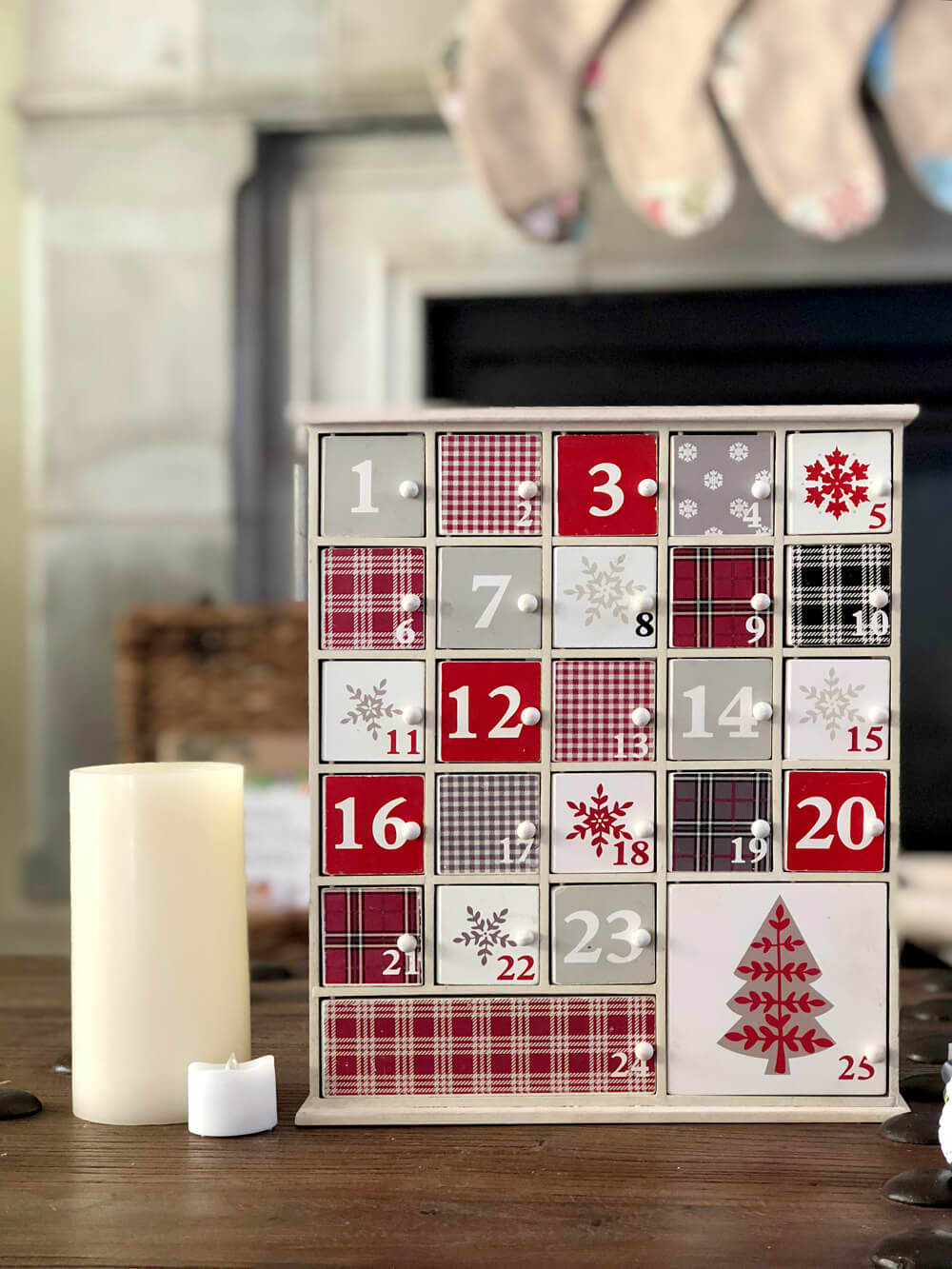 Advent calendar decor in front of Rustic Woodland Christmas Mantel