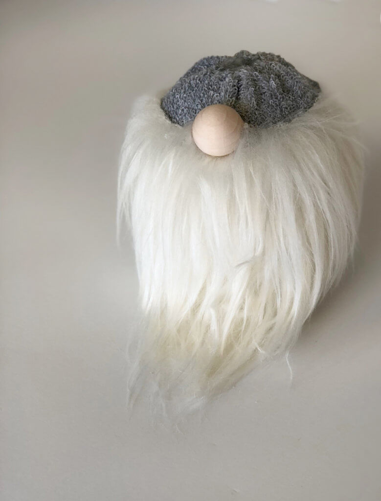 Wooden ball nose in a simple no sew gnome tutorial Scandinavian Christmas tomte