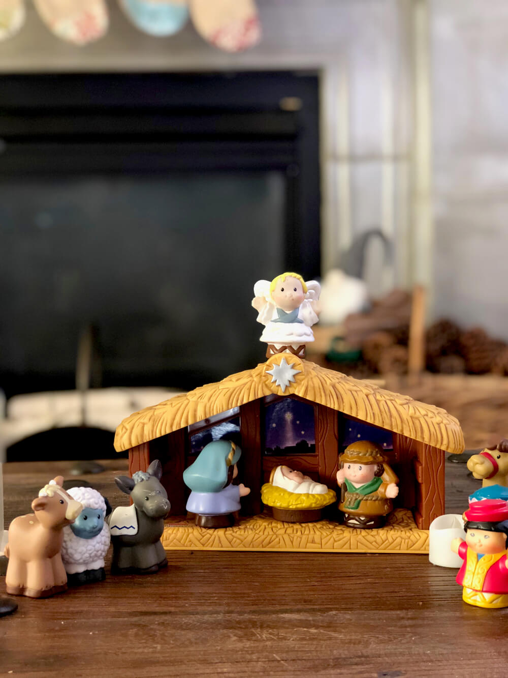 Little People nativity set for children with rustic woodland Christmas in background