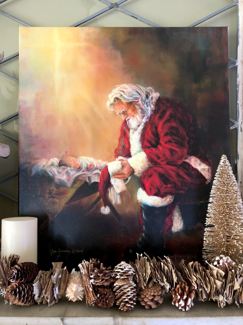 Print of Santa kneeling next to baby Jesus on rustic woodland Christmas mantel