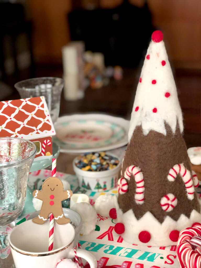 Felt gingerbread tree centerpiece on decorated table for a Christmas Cookie Exchange Party