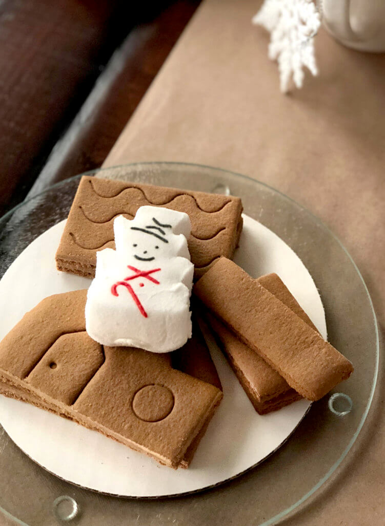 Mini gingerbread house kit for a Christmas Cookie Exchange Party Activity