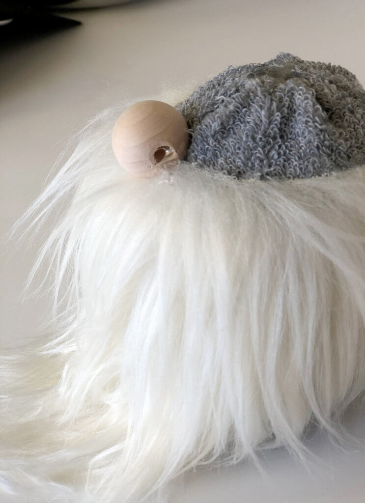 Glue the nose on a simple no sew gnome tutorial Scandinavian Christmas tomte